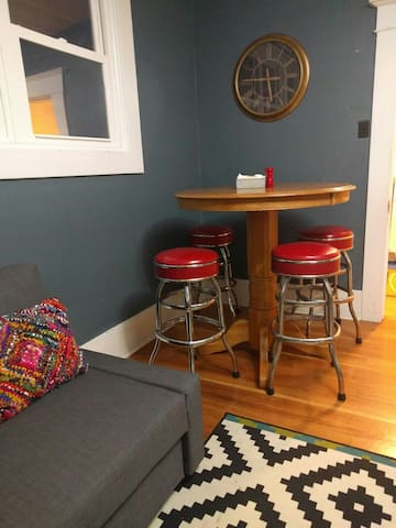 Sitting room with table and bar stools.