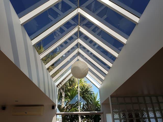 Big glass atrium roof in the living area