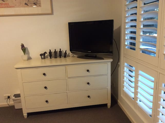 TV and chest of drawers in bedroom