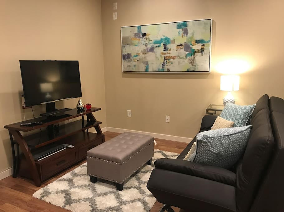 Comfortable seating area with flat screen TV.