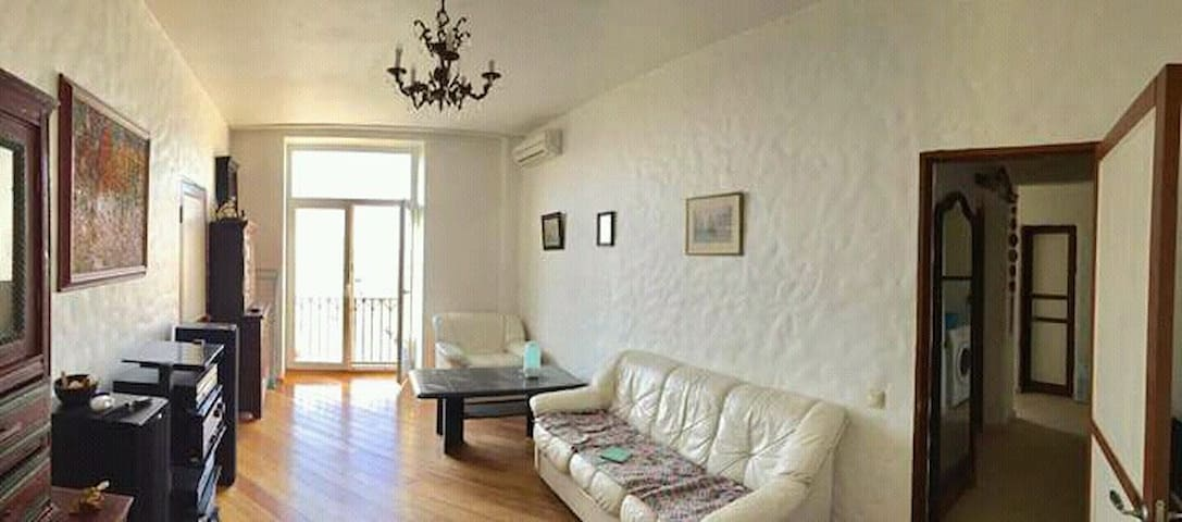 Big one room with balcony and sofa
