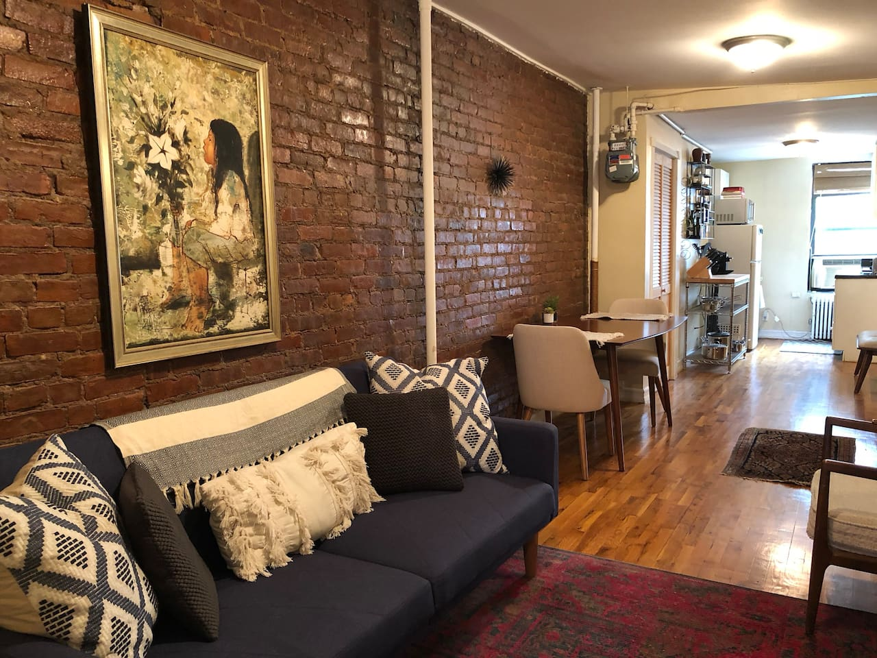 Floor through apartment with exposed brick throughout
