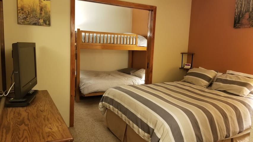 Bedroom with pocket door between sleeping areas for privacy