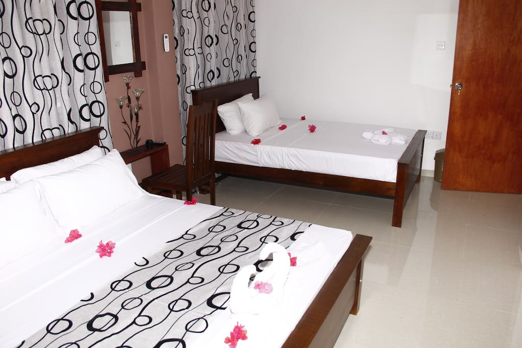 Family room, one king size bed and one double  bed.