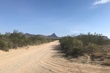 "This is the last stretch of road you will drive on for just over a mile to arrive at the ""Big Bend Glamping"" property. It is the only stretch of road that is unpaved, but as you can see it is a flat, well-maintained road that is accessible by any vehicle."