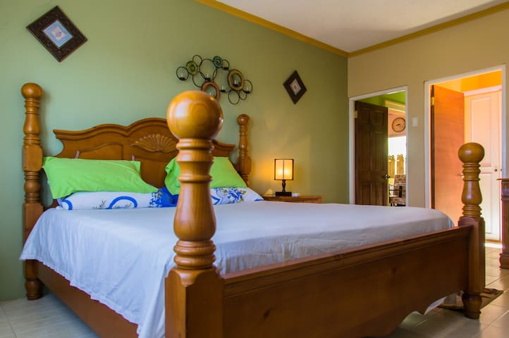 Sleep well in this cozy king-sized bed.