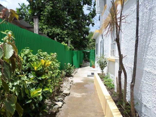 Walkway to entrance of Inniss Apartment