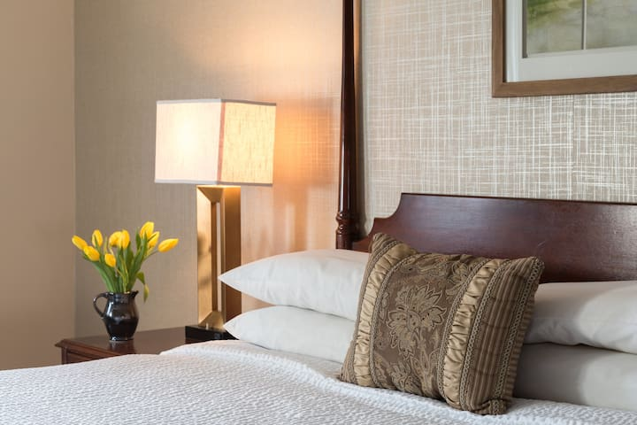 Deluxe King Room steps from shops and restaurants