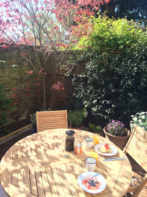 Our walled courtyard garden is perfect for sunny meals