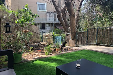 Private room with a small garden in Haifa