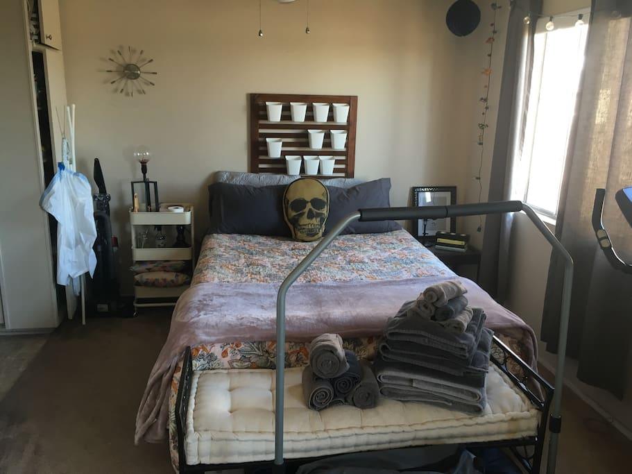 Bedroom area. Ceiling fan above bed.