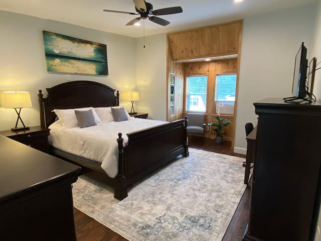 Master bedroom. King-sized bed, reading nook, and workspace.  TV with ROKU.
