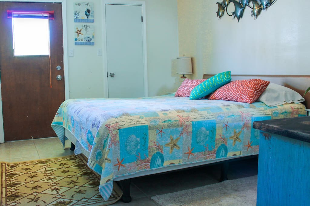 The Bayside master bedroom boasts a spacious king-size bed