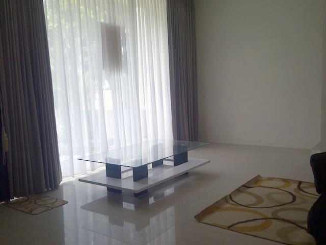 glass wall with sliding door @ the living room + full curtain