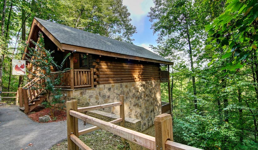 Nestled in the trees, what a location! Right between Pigeon Forge & Gatlinburg.