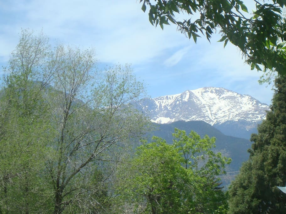 VIEW OF PIKES PEAK FROM THE WINDOW IN THE LIVING ROOM
