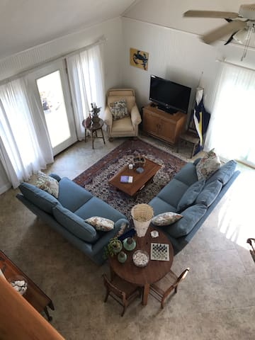 Second floor with cathedral ceiling creates a bright roomy entertainment area.