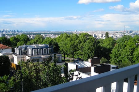 Studio dans la verdure dominant Paris