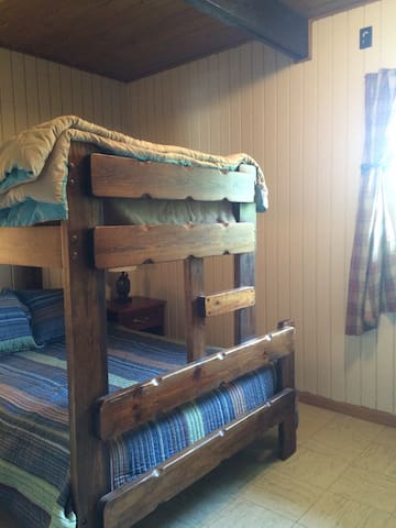 Full size bed with twin lofted above it. Great for couples or families.