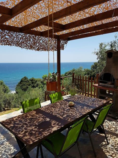 romantic house next to  the sea