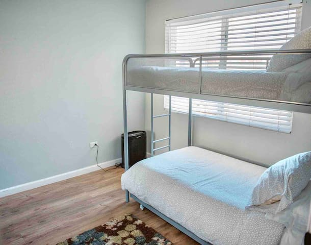 Guest room with 3 single beds