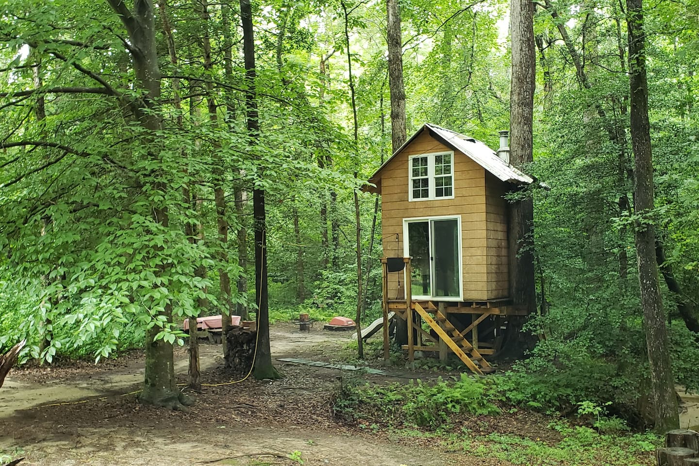 This tiny house started as just a platform with a slide, as a fort and playground for our children. Over the years, it grew just like they did.
