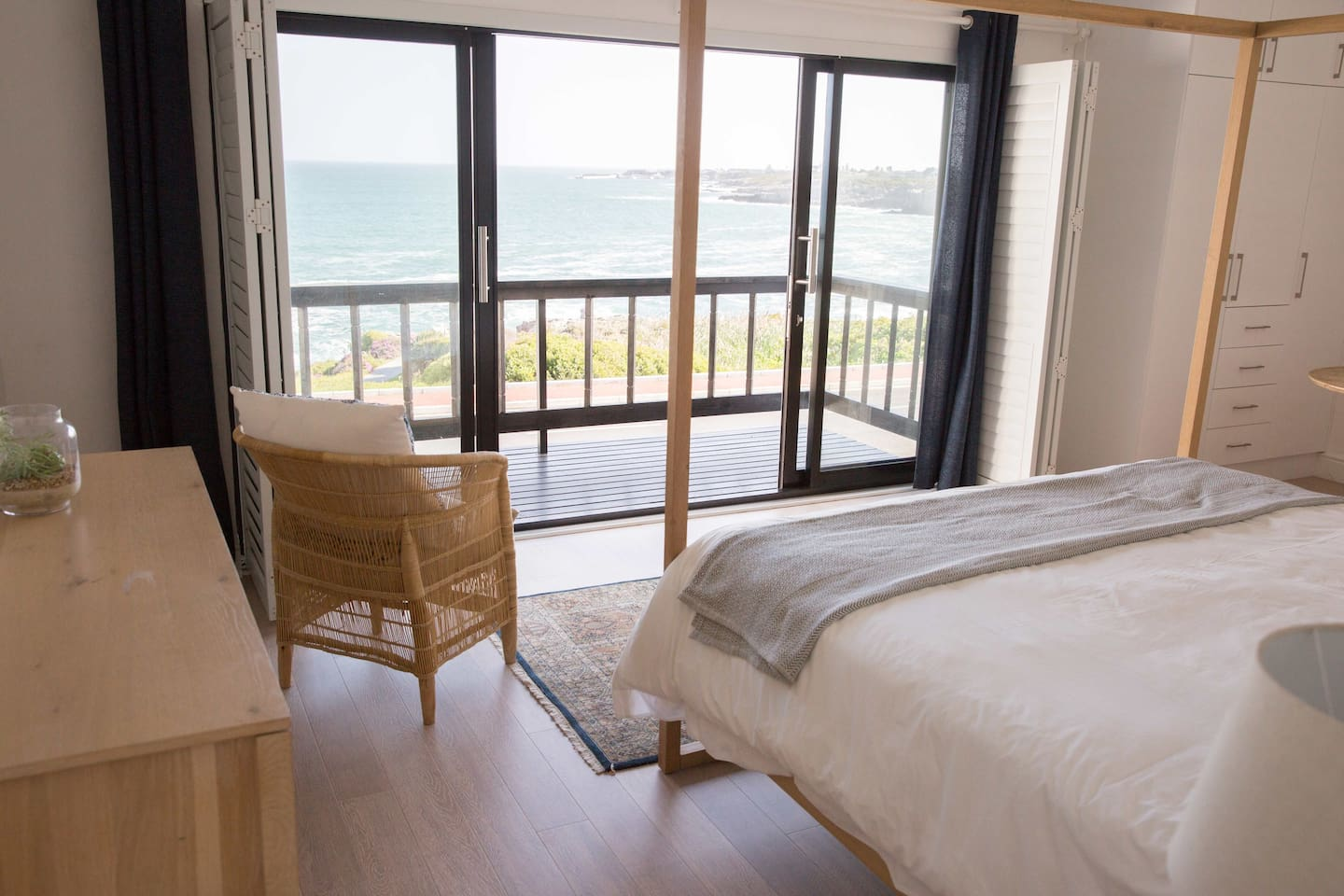 Main bedroom - listen to the ocean and watch the whales from the comfort of your king size bed