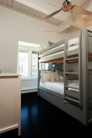 Bunk room -- full sized bed over full sized bed with a pull out twin below