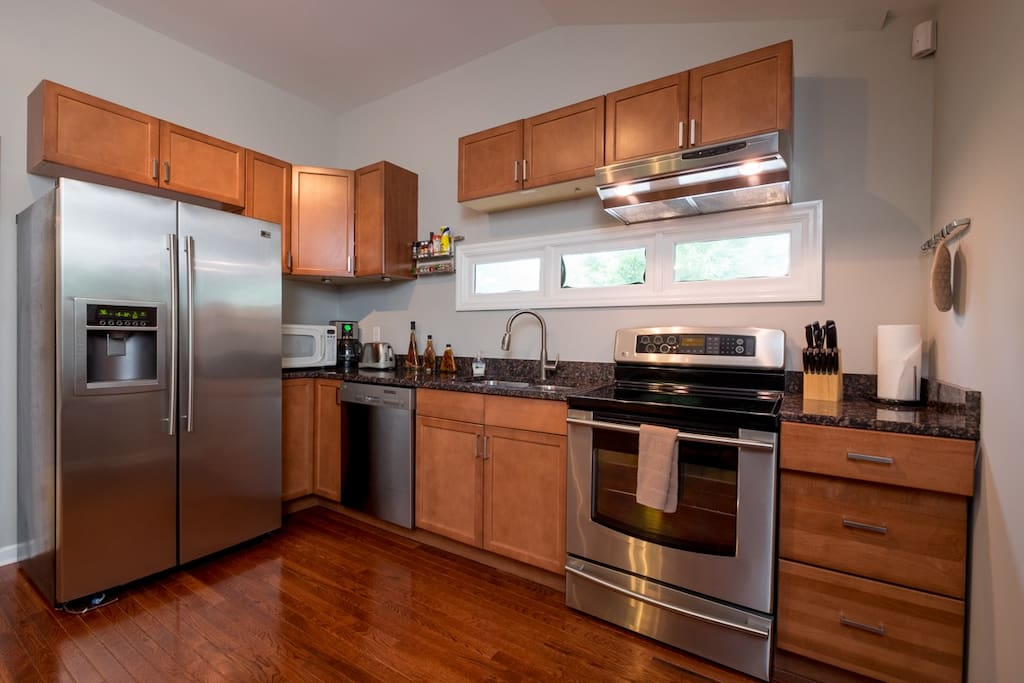 Full kitchen includes fridge, freezer, dishwasher, oven, stove, microwave, cooking utensils, coffee maker, etc.!