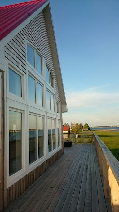 View along the wrap around deck - perfect for enjoying summer weather.