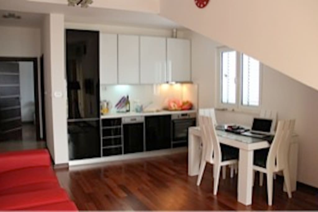 Bright well equipped kitchen dining area.
