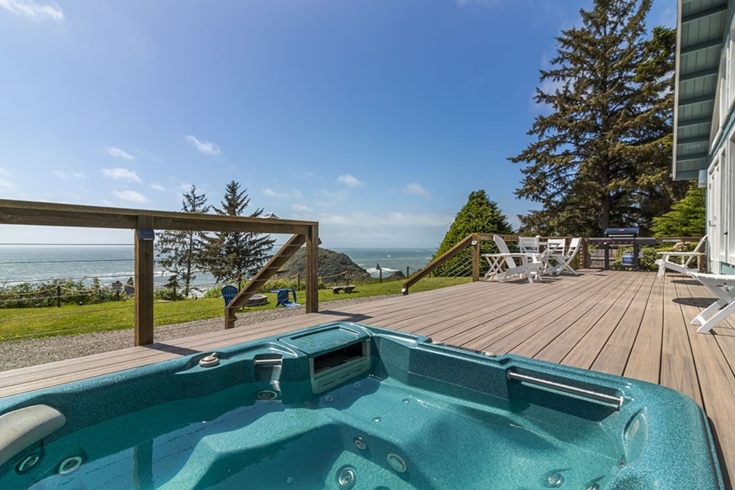 Relax in the hot tub while soaking up sweeping ocean views!