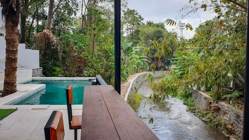 Secluded Riverside Bungalow with Jungle Views
