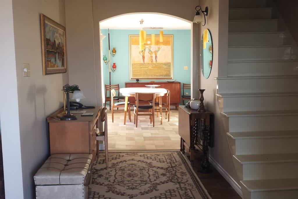 This is the view  as you enter - the Dining is straight ahead, the Living Room, Powder Room and Back door to Deck is on the left and the Master Bedroom, Ensuite and WIC are to the right of the stairs.