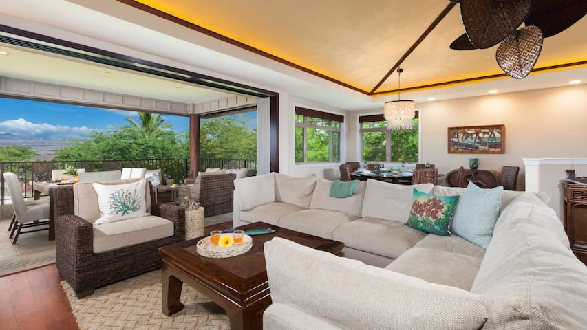 """Large open concept living room with comfy sectional and 65"""" UltraHD 4K Smart TV with Netflix, AppleTV and Cable."""