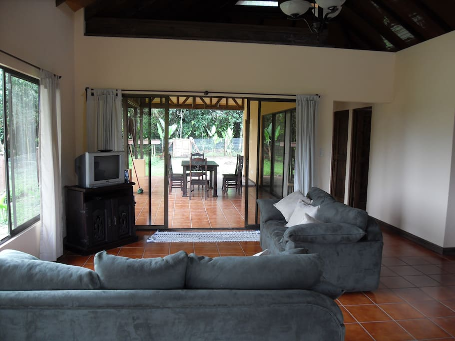 View of the living room open to back terrace