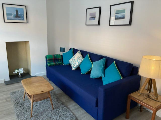 Lounge with a brand new large sofa / double sofa bed