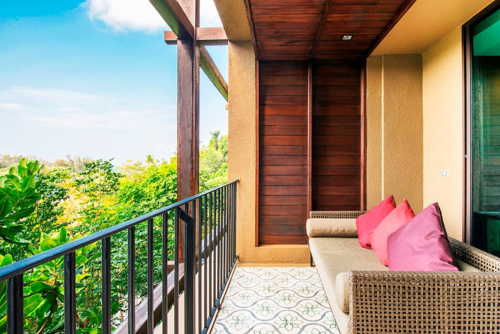 Large balcony with large sofa to relax with cup of coffee
