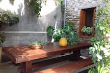 Monastery table on the front yard of Melanthia House