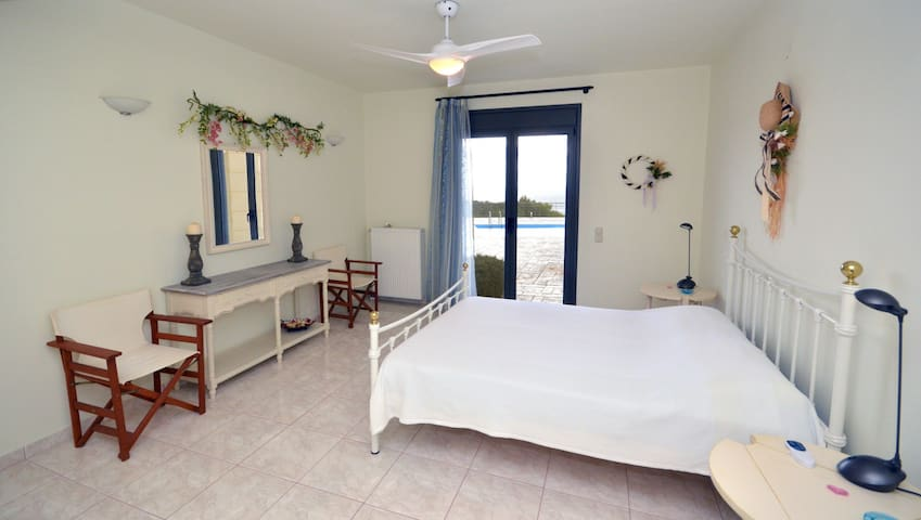 Aphaia Villa II - Lower Ground (Pool) Level - 1st Double Bedroom with direct access to the pool
