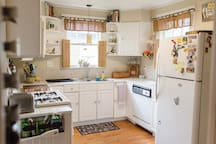 Shared space downstairs: The full kitchen contains a four burner gas stove. You are welcome to use our full size refrigerator as well.