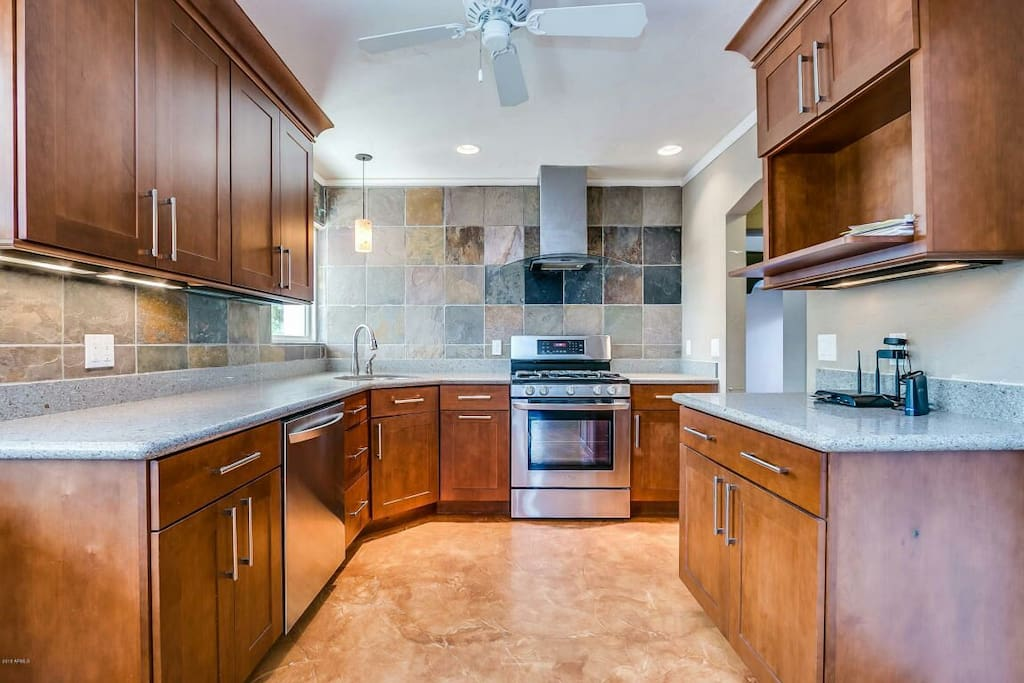 Main kitchen (house has two kitchens) can accommodate cooking for big groups.