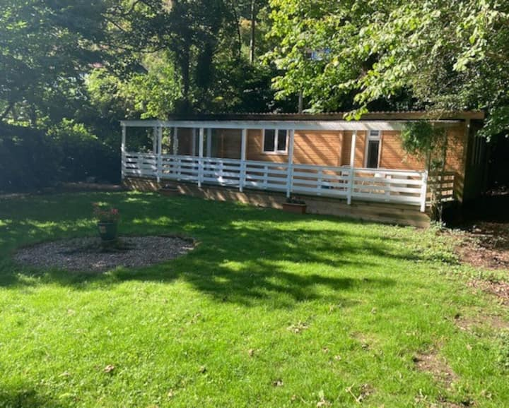 Lovely lodge/Chalet  in own mature grounds
