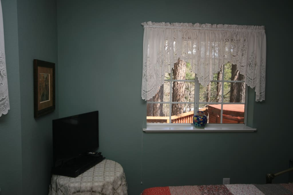 Your quiet room is at the far end of the home, overlooking the deck, hot tub, and a wooded lot.