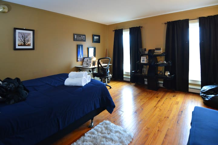 """""""Modern Traveler"""" bedroom pictured with fabulous natural daytime light."""