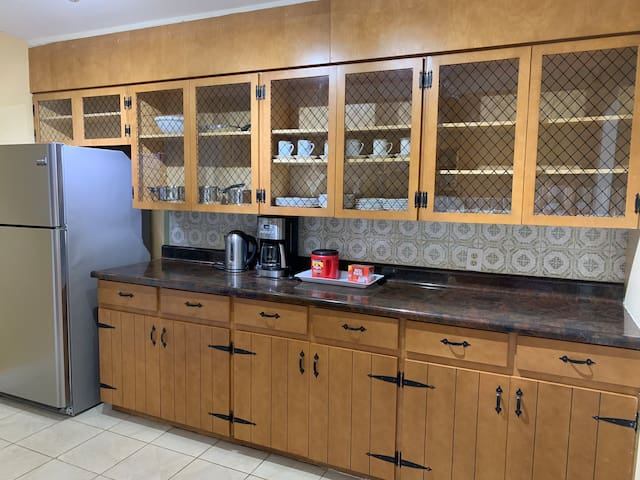 we have a large kitchen with pots, plates, cups, and cutlery. Microwave , caffeemaker with coffee, kettle, toster.