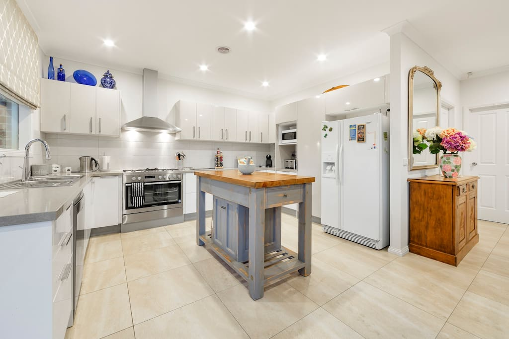 The well-equipped and fitted-out kitchen is enormous. It has two large fridges, a large oven and cook-top, as well as plenty of crockery, cutlery, utensils and storage space