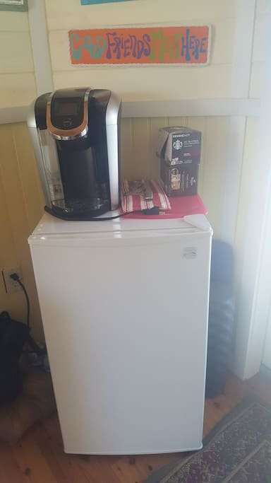 Comes equipped with a mini fridge, coffee maker, & microwave