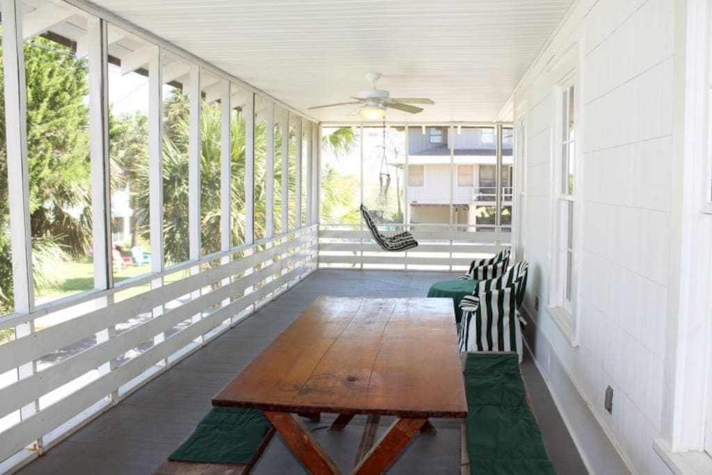 Large wrap-around screened porch to enjoy coffee, cocktails, friends and family