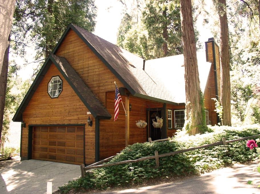 Home nestled among trees and close to walk to the lake, beach club or Village